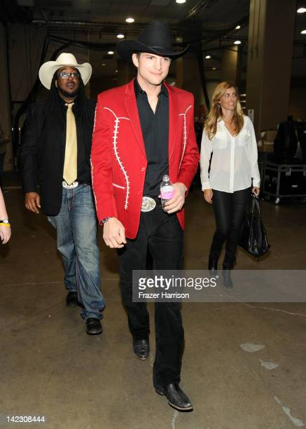 Actor Ashton Kutcher poses backstage at the 47th Annual Academy Of Country Music Awards held at the MGM Grand Garden Arena on April 1 2012 in Las...
