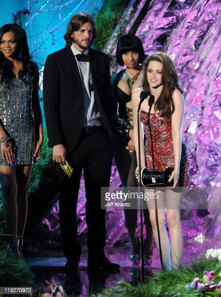 Actor Ashton Kutcher singer Nicki Minaj and actress Kristen Stewart speak onstage during the 2011 MTV Movie Awards at Universal Studios' Gibson...