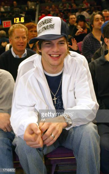 Actor Ashton Kutcher sits courtside as the Portland Trail Blazers visit the New York Knicks at Madison Square Garden on January 5 2003 in New York...