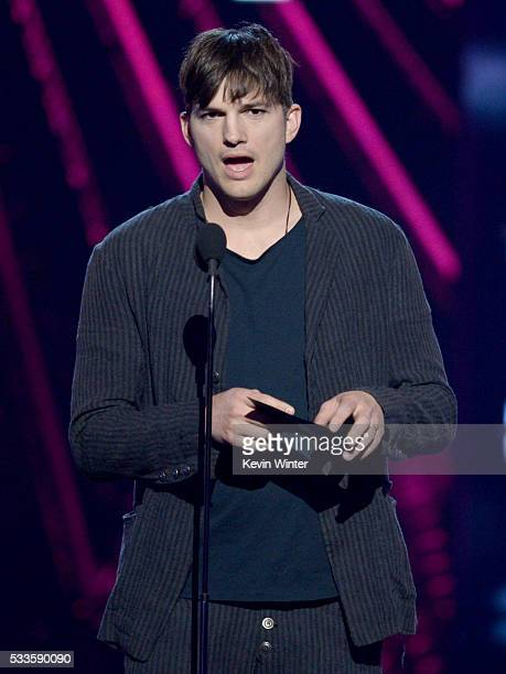Actor Ashton Kutcher speaks onstage during the 2016 Billboard Music Awards at TMobile Arena on May 22 2016 in Las Vegas Nevada