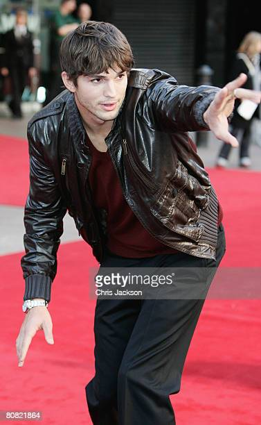 Actor Ashton Kutcher waves to fans as he attends the World Premiere of 'What Happens In Vegas' held at the Odeon Leicester Square on April 22 2008 in...