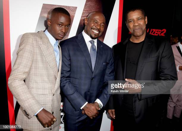 Actor Ashton Sanders director Antoine Fuqua and actor Denzel Washington arrive at the premiere of Columbia Picture's Equalizer 2 at the Chinese...