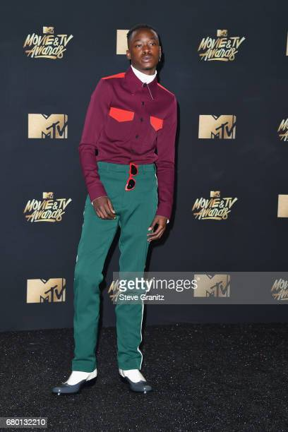Actor Ashton Sanders winner of Best Kiss for 'Moonlight' poses in the press room during the 2017 MTV Movie and TV Awards at The Shrine Auditorium on...