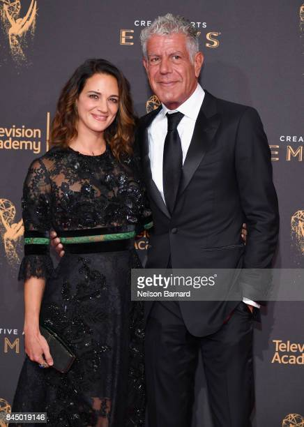 Actor Asia Argento and Anthony Bourdain attend day 1 of the 2017 Creative Arts Emmy Awards at Microsoft Theater on September 9 2017 in Los Angeles...