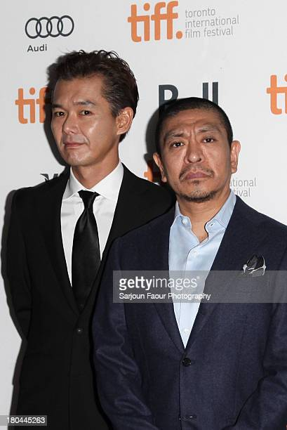 "Actor Atsuro Watabe and Director Hitoshi Matsumoto arrive at the ""R100"" premiere during the 2013 Toronto International Film Festival at Ryerson..."