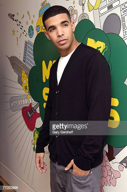 Actor Aubrey Graham of the cast of DeGrassi High of DeGrassi High pose for pictures while visiting MTV's TRL at MTV Studios in Times Square on...