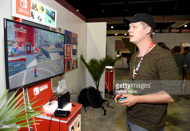 Actor Austin Anderson plays Super Mario Odyssey at the Nintendo booth at the 2017 E3 Gaming Convention at Los Angeles Convention Center on June 14...