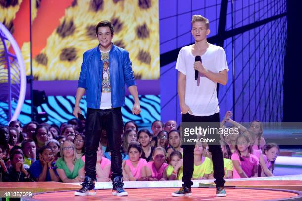 Actor Austin Mahone and singer Cody Simpson appear onstage during Nickelodeon's 27th Annual Kids' Choice Awards held at USC Galen Center on March 29...
