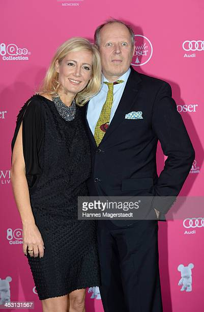 Actor Axel Milberg and his wife Judith Milberg attend the Closer Charity Event SMILE at Hotel Vier Jahreszeiten on December 2 2013 in Munich Germany
