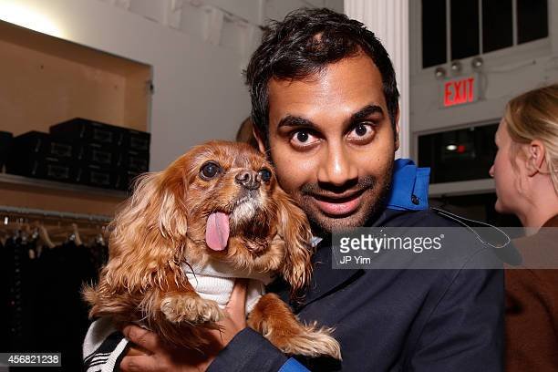 Actor Aziz Ansari and fourlegged friend Toast attend the Band of Outsiders and Bon Appetit Magazine celebration of the opening of Milk Bar Soho at...