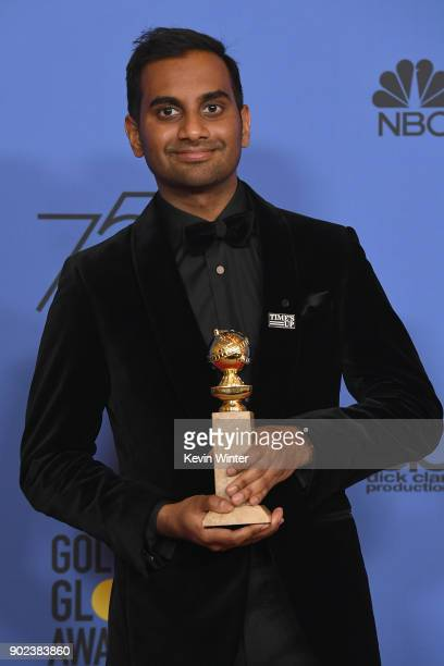 Actor Aziz Ansari poses with his award for Best Performance by an Actor in a Television Series Musical or Comedy for 'Master of None' in the press...
