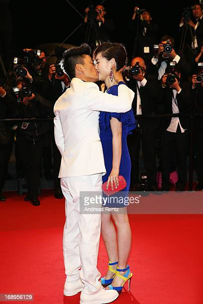 Actor Baoqiang Wang kisses his girlfriend Ma Rong during the Premiere of 'Tian Zhu Ding' during The 66th Annual Cannes Film Festival at Palais des...