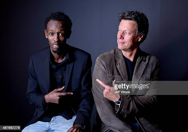 Actor Barkhad Abdi and director Gavin Hood from 'Eye In The Sky' pose for a portrait during the 2015 Toronto International Film Festival at the TIFF...