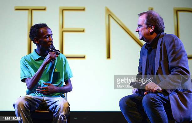 Actor Barkhad Abdi speaks to moderator Pete Hammond onstage at Deadline Hollywood's The Contenders on November 2 2013 in Beverly Hills California