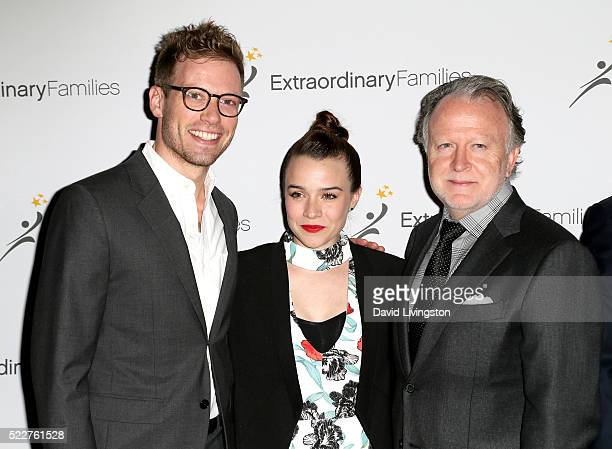 Actor Barrett Foa actress Renee Felice Smith and writer Shane Brennan arrive at the Extraordinary Families Gala at The Beverly Hilton Hotel on April...