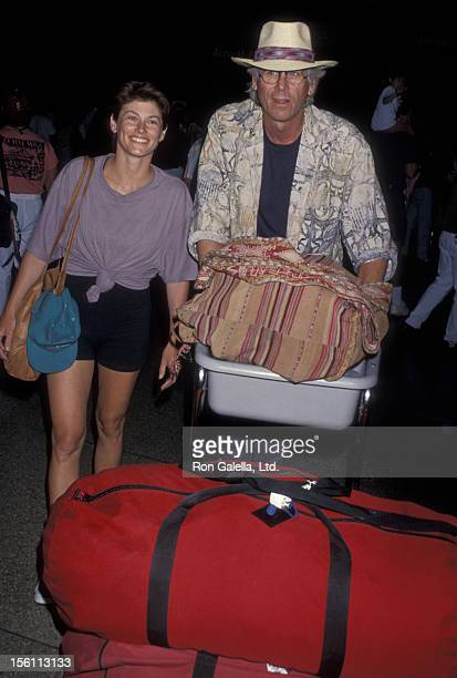 Actor Barry Bostwick and wife Sherri Jensen being photographed on April 10 1994 at the Los Angeles International Airport in Los Angeles California