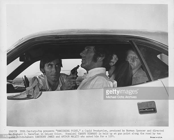 Actor Barry Newman is held up by hitchhikers Arthur Malet and Anthony James in the film 'Vanishing Point' Photo by Michael Ochs Archives/Getty Images