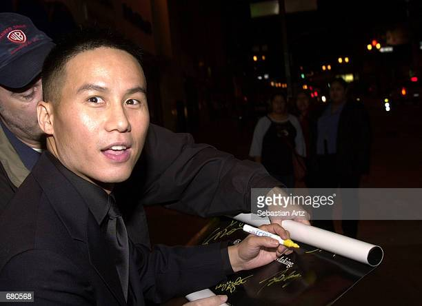 Actor BD Wong autographs a poster at the Second Annual AMMY Awards For Asian American Entertainment November 10 2001 in Los Angeles CA