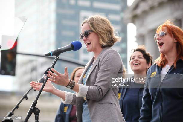 Actor Becky Gulsvig performs with other cast members of 'Come From Away' at the Women's March San Francisco in Civic Center Plaza on January 19 2019...