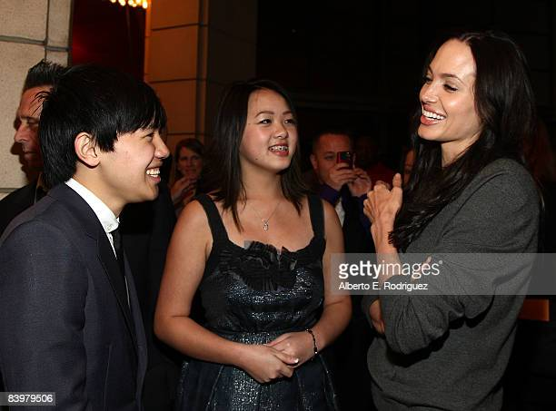 Actor Bee Vang actress Ahney Her and actress Angelina Jolie arrive at the world premiere of Warner Bros Pictures' Gran Torino held at the Warner...