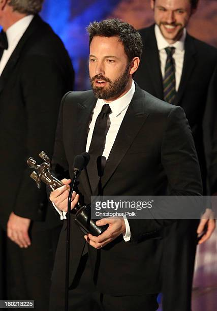 Actor Ben Affleck accepts the award for Outstanding Performance by a Cast in a Motion Picture for 'Argo' onstage during the 19th Annual Screen Actors...