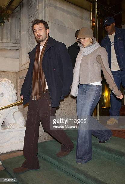Actor Ben Affleck and actress/singer Jennifer Lopez exiting a midtown hotel on their way to do some holiday shopping December 12 2003 in New York City