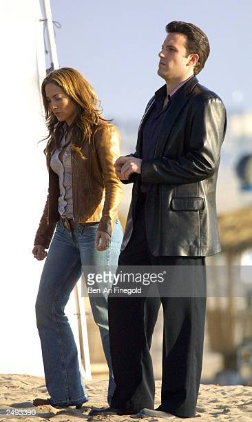 Actor Ben Affleck and actress/singer Jennifer Lopez film a scene on the set of their upcoming movie Gigli at Will Rodgers Beach on January 12 2003 in...