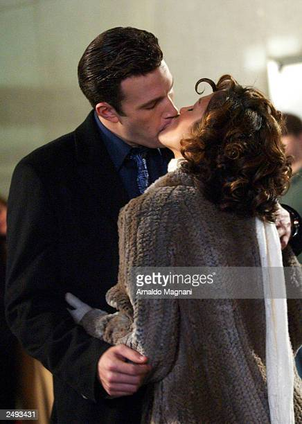 Actor Ben Affleck and his girlfriend actress Jennifer Lopez kiss while filming on the set of Jersey Girl Lopez and Affleck postponed their wedding...