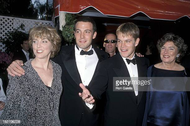 Actor Ben Affleck and mother Chris Boldt and actor Matt Damon and mother Nancy CarlssonPaige attend the 70th Annual Academy Awards on March 23 1998...