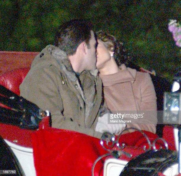 Actor Ben Affleck and singer Jennifer Lopez kiss while riding a horse carriage on Cherry Hill in Central Park November 7, 2002 in New York City.