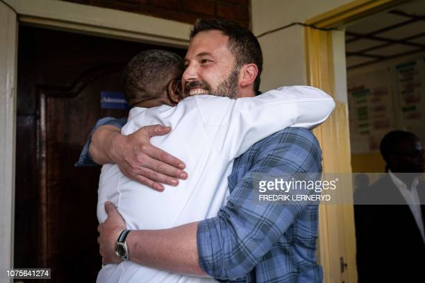 US Actor Ben Affleck is welcomed by 2018 Nobel Peace Prize laureate Doctor Denis Mukwege upon his arrival at the Panzi hospital in Bukavu ahead of a...