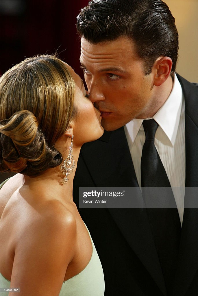 Actor Ben Affleck kisses fiancee, actress Jennifer Lopez at the 75th Annual Academy Awards at the Kodak Theater on March 23, 2003 in Hollywood, California. Lopez and Affleck postponed their wedding, which was scheduled for this weekend, and has now reportedly spit up, possibly temporarily.