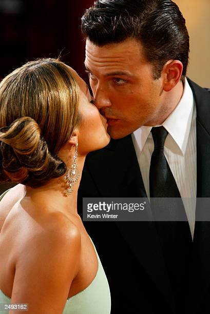 Actor Ben Affleck kisses fiancee actress Jennifer Lopez at the 75th Annual Academy Awards at the Kodak Theater on March 23 2003 in Hollywood...