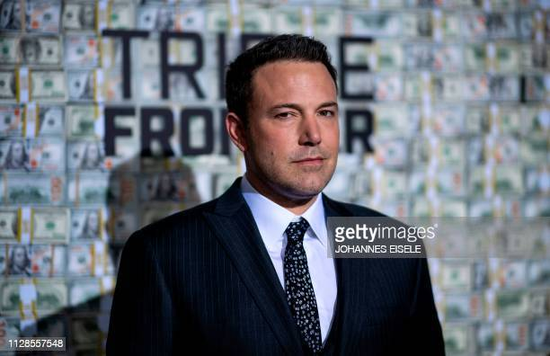 US actor Ben Affleck poses as he arrives for the world premiere of Triple Frontier on March 3 2019 in New York City The movie will be released in...