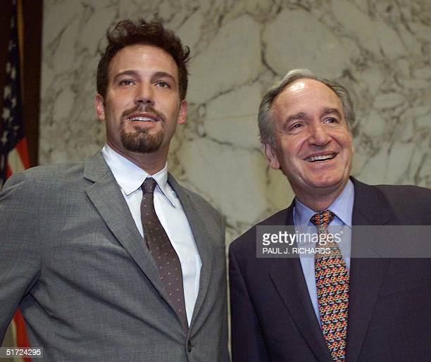 US actor Ben Affleck poses with US Senator and Chairman of the Appropriations Subcommittee on LaborHealth Human Services and Education Tom Harkin on...