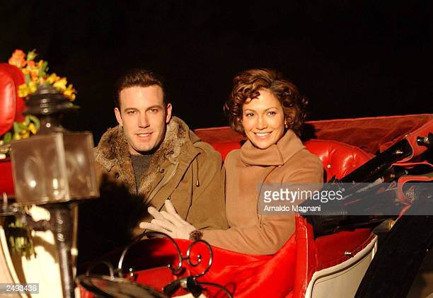 Actor Ben Affleck rides a horse carriage with costar Jennifer Lopez during the filming of 'Jersey Girl' November 7 2002 in New York City Lopez and...