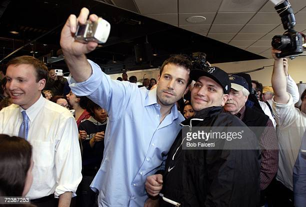 Actor Ben Affleck takes a picture with a student as he visits the campus of Central Connecticut State University to campaign for Democratic U.S....