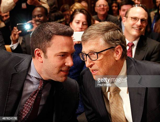 Actor Ben Affleck talks with Bill Gates cochair of the Bill Melinda Gates Foundation before they testify before a Senate Appropriations State Foreign...