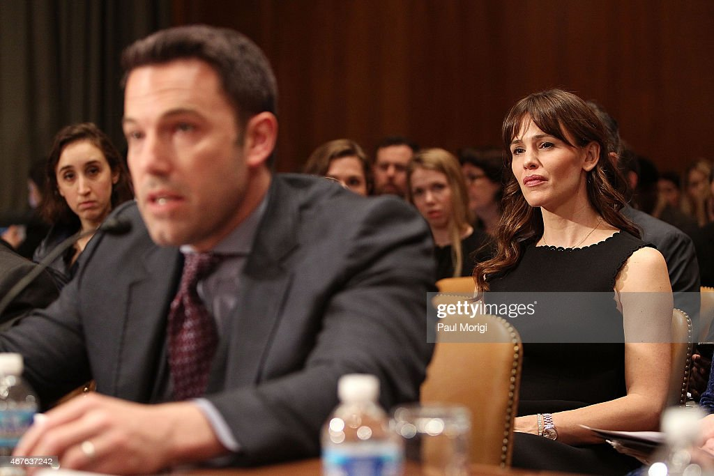 Actor Ben Affleck testifies, while his wife actress Jennifer Garner listens, before a Senate Appropriations State, Foreign Operations, and Related Programs Subcommittee hearing on 'Diplomacy, Development, and National Security' on Capitol Hill in Washington March 26, 2015.