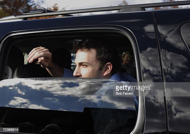 Actor Ben Affleck waves from a car as he visits the campus of Central Connecticut State University to campaign for Democratic U.S. Congress candidate...