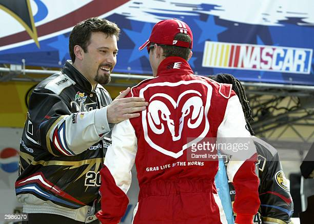 Actor Ben Afleck as Grand Marshal is introduced to Kasey Kahne driver of the Evernham Motorsports Dodge during the pre race ceremonies at the NASCAR...