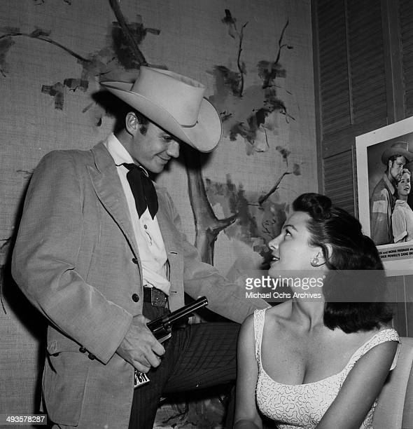 Actor Ben Cooper and Jeannie Carson poses during a costume ball in Los AngelesCalifornia