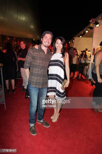 Actor Ben Feldman and actress Aimee Garcia attends LEXUS Live on Grand hosted by Curtis Stone at the third annual Los Angeles Food Wine Festival on...