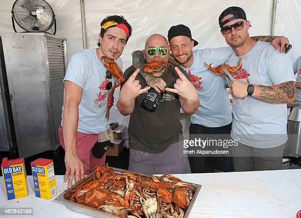 Actor Ben Feldman and chefs Duff Goldman Michael Voltaggio and Bryan Voltaggio attend Crab Cake LA on August 2 2015 in Los Angeles California