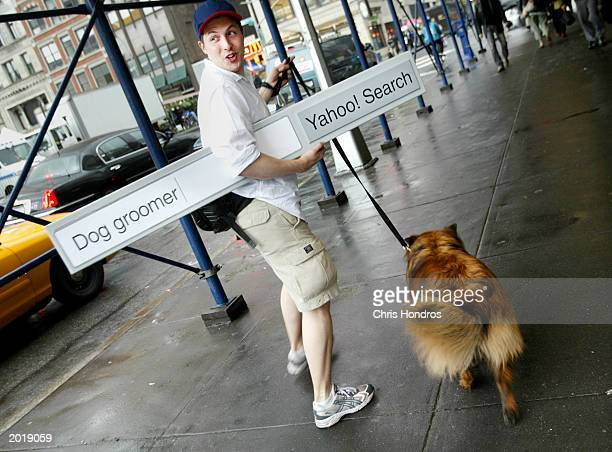 Actor Ben Hauck carries a five-foot search bar in a promotion for the re-release of the Yahoo! Web search engine May 21, 2003 in Union Square, New...