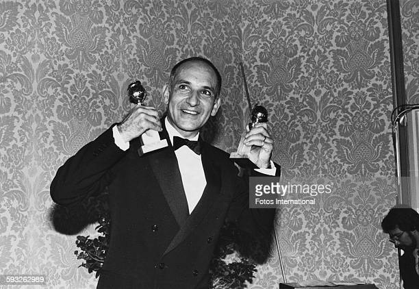 Actor Ben Kingsley holding his two awards for the film 'Gandhi' at the Golden Globe Awards at the Beverly Hilton Hotel California January 29th 1983