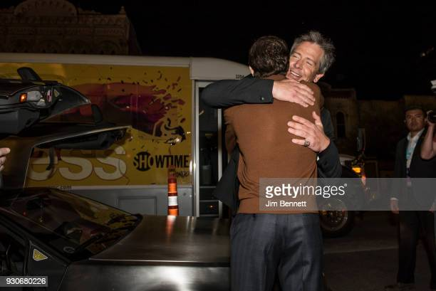 Actor Ben Mendelsohn give actor Tye Sheridan a hug in front of a Delorean at the Paramount Theatre during the world premiere of Ready Player One...