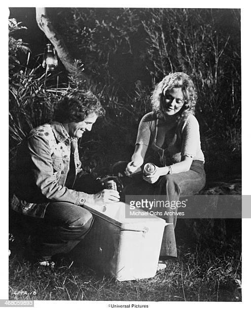 "Actor Ben Murphy and actress Vicki Raymond on set of the movie ""Sidecar Racers"" circa 1975."