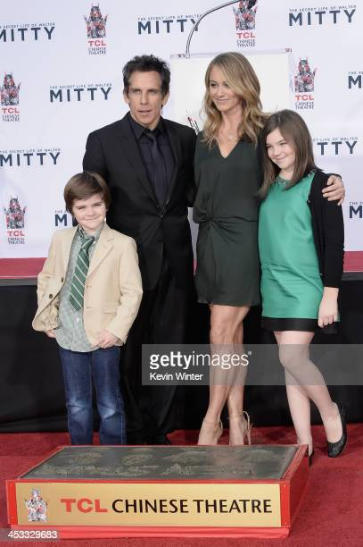 Actor Ben Stiller poses with his wife actress Christine Taylor and their children Quinlin Stiller and Ella Stiller as he is honored with a hand and...