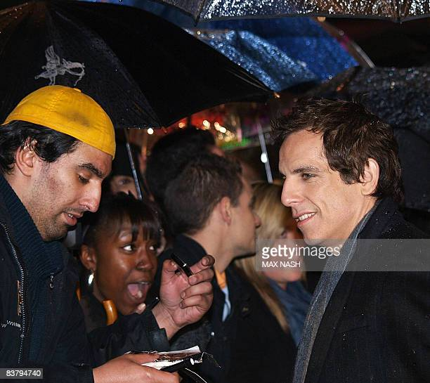 Actor Ben Stiller signs autographs to fans after arriving in London's Leicester Square to attend the British Premiere of his latest film 'Madagascar...